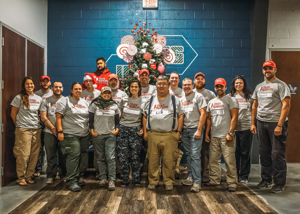 Team Rubicon, a volunteer group of veterans and active military, gather for a picture.