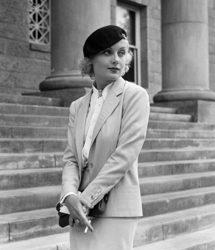 In this Aug. 18, 1933, file photo, Carole Lombard, well known screen actress shown on the courthouse steps at Carson City, Nev., following her divorce from her husband, William Powell.