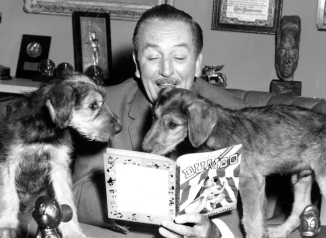 Walt Disney reading aloud from an early Golden Book. Or trying to.