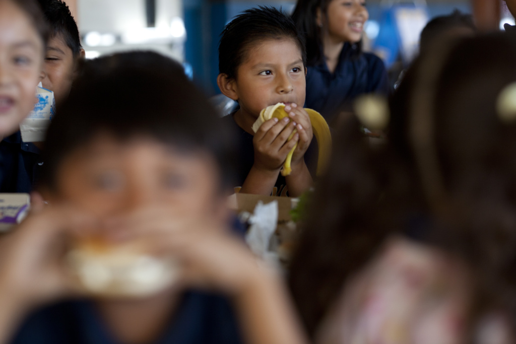 FILE: Adan Perechu, 7, eats a banana during lunch at Gratts Learning Academy for Young Scholars in Los Angeles. A national survey finds that more school districts are serving breakfast in the classroom.