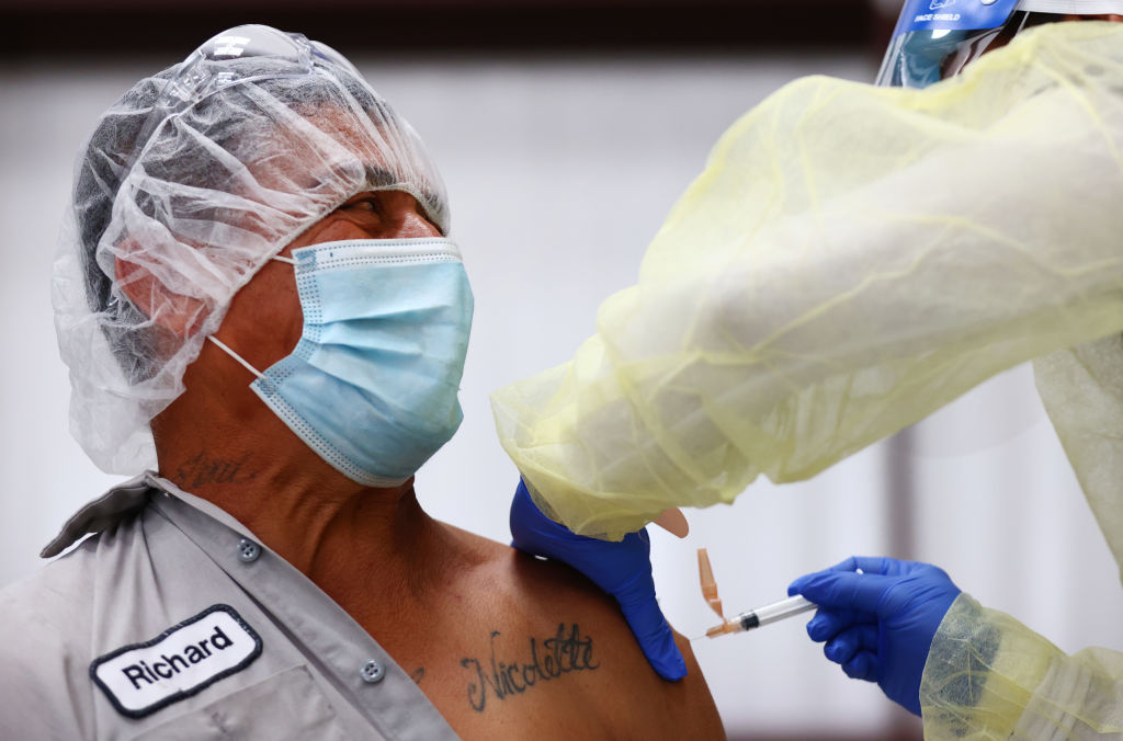 Richard Padilla receives a one shot dose of the Johnson & Johnson COVID-19 vaccine at a clinic geared toward agriculture workers organized by TODEC on April 05, 2021 in Riverside, California.