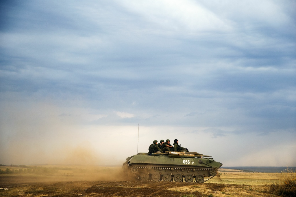 A Russian APC moves in a field in about 10 kilometers (6.2 miles) from the Russia-Ukrainian border control point at Russian town of Donetsk, Rostov-on-Don region, Monday, Aug. 18, 2014.