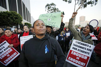 Los Angeles teachers and parents join to protest school cuts outside the offices of the Los Angeles Unified School District on Tuesday, Dec. 8, 2009. in Los Angeles.