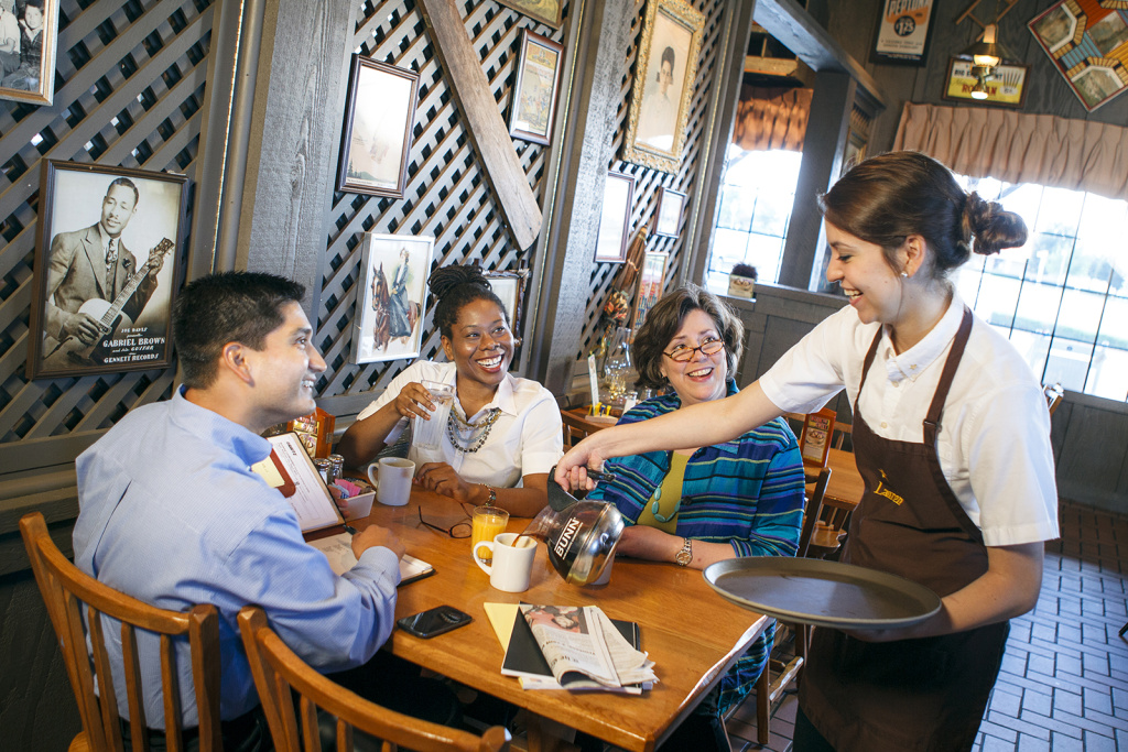 A group of people eat at a Cracker Barrel