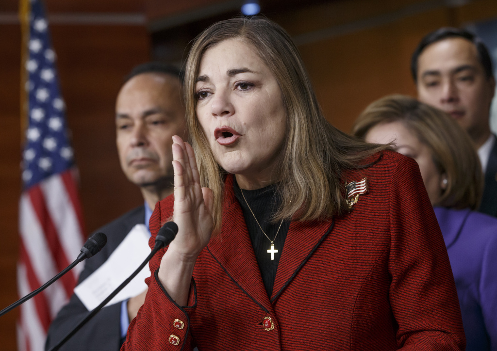 FILE - In this Feb. 13, 2015, file photo, Rep. Loretta Sanchez, D-Calif., joined at left by Rep. Luis Gutierrez, D-Ill., and others, responds to questions during a Congressional Hispanic Caucus news conference on Capitol Hill in Washington.