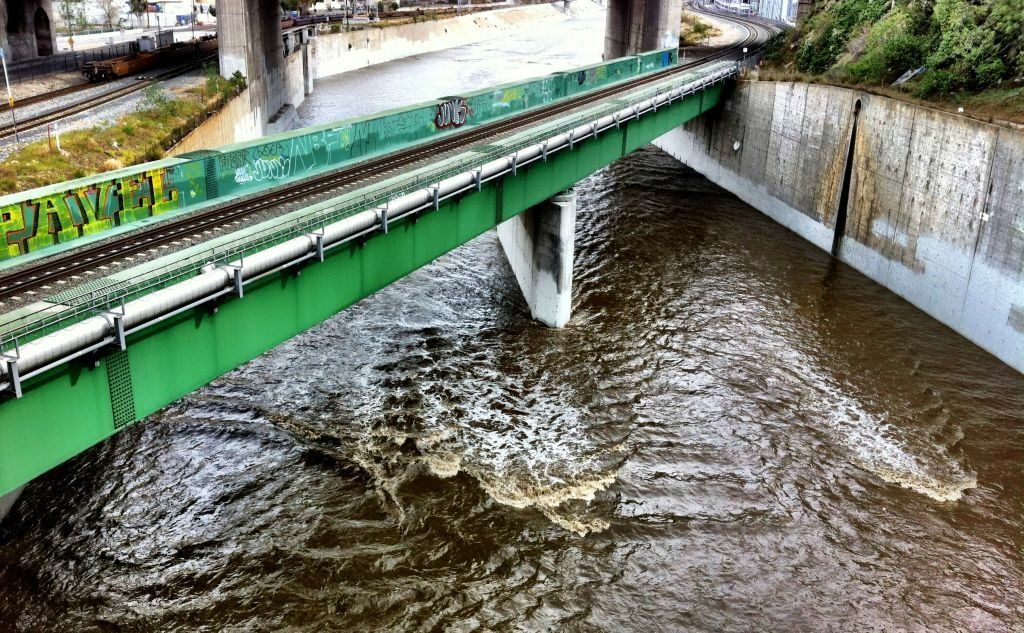 Rain passes under L.A. River on Saturday taken from the Riverside Drive bridge in Cypress Park.