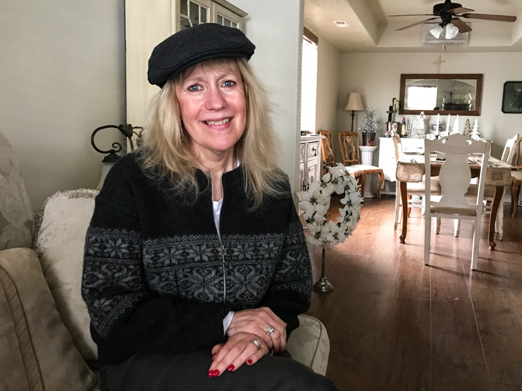 Adrien Koch, 62, sits in the bedroom of her northern Idaho home, which is twice as big and half as expensive as the one she sold in California.