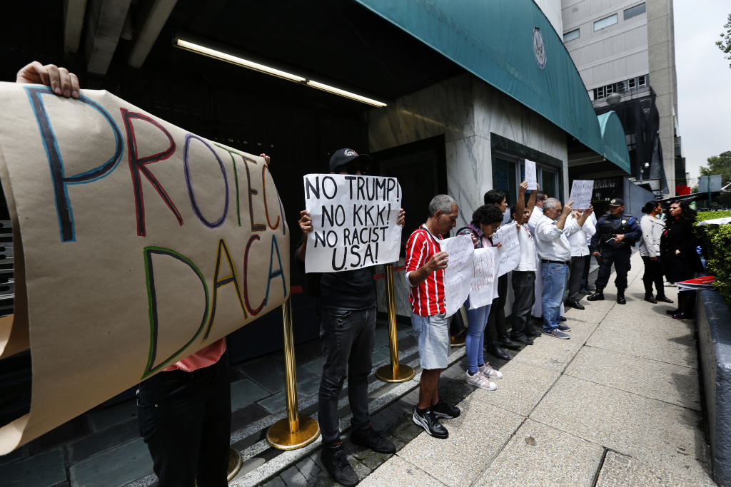 People hold posters in support of immigration during a protest in support of the Deferred Action for Childhood Arrivals, DACA, outside of the U.S. embassy in Mexico City, Wednesday, Sept. 6, 2017. President Donald Trump plans to phase out the DACA program that has protected hundreds of thousands of young immigrants brought into the country illegally as children and is calling for Congress to find a legislative solution. (AP Photo/Marco Ugarte)