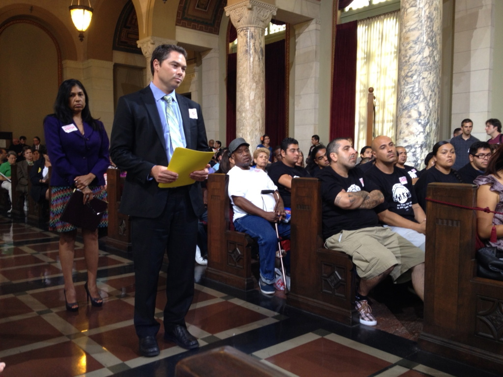 Supporters of USC's redevelopment plan for South LA line up during the public comment session at City Hall.