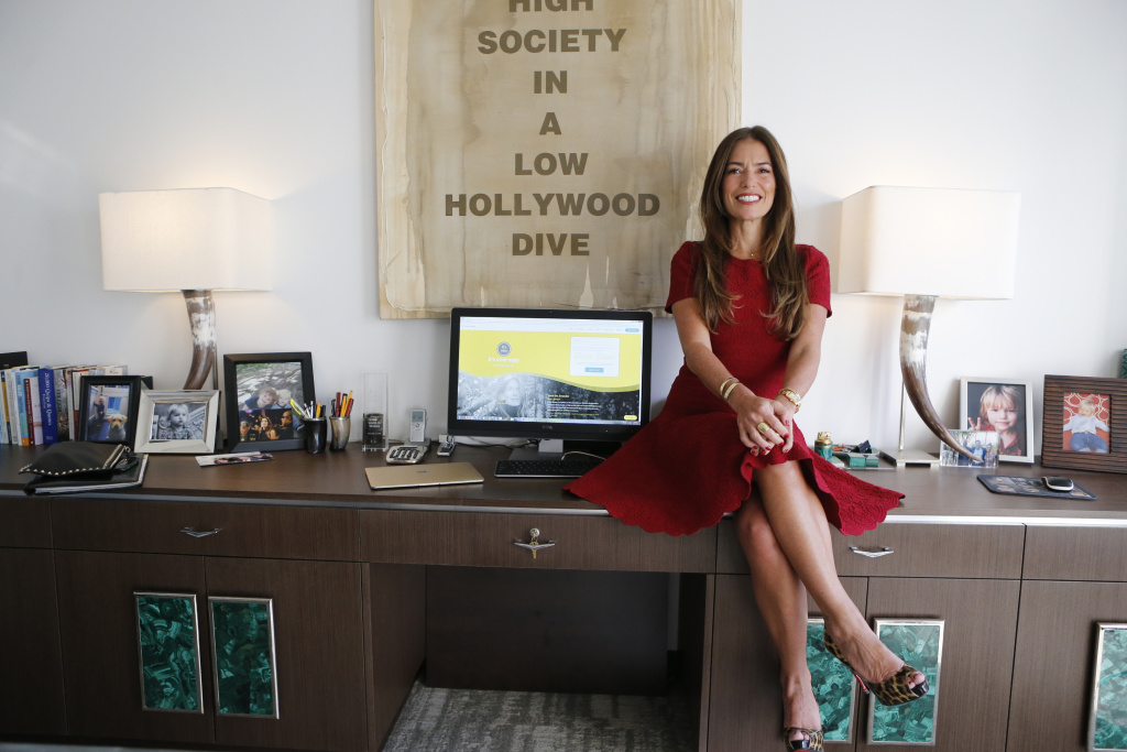 In this Jan. 12, 2018, photo, divorce attorney Laura Wasser, who has represented celebrities like Britney Spears and Johnny Depp, poses at her Century City office in Los Angeles. On Thursday, Jan. 25, Wasser is launching a new website and service called, It's Over Easy, that aims to help couples get divorced online without having to hire an attorney or set foot into a courthouse.