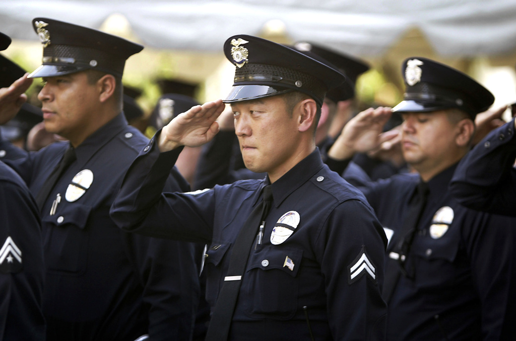 On May 3, 2003, Los Angeles Police Department (LAPD) officers salute during an LAPD ceremony to pay tribute to the 194 Los Angeles officers who have died since 1907. The annual ceremony, held during National Police Week, honors all fallen police personnel but gave special tribute to two who were killed this past year.