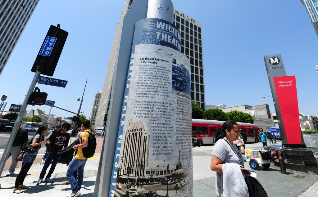 Pedestrians in Koreatown are seen at the intersection of Wilshire and Western in Los Angeles.