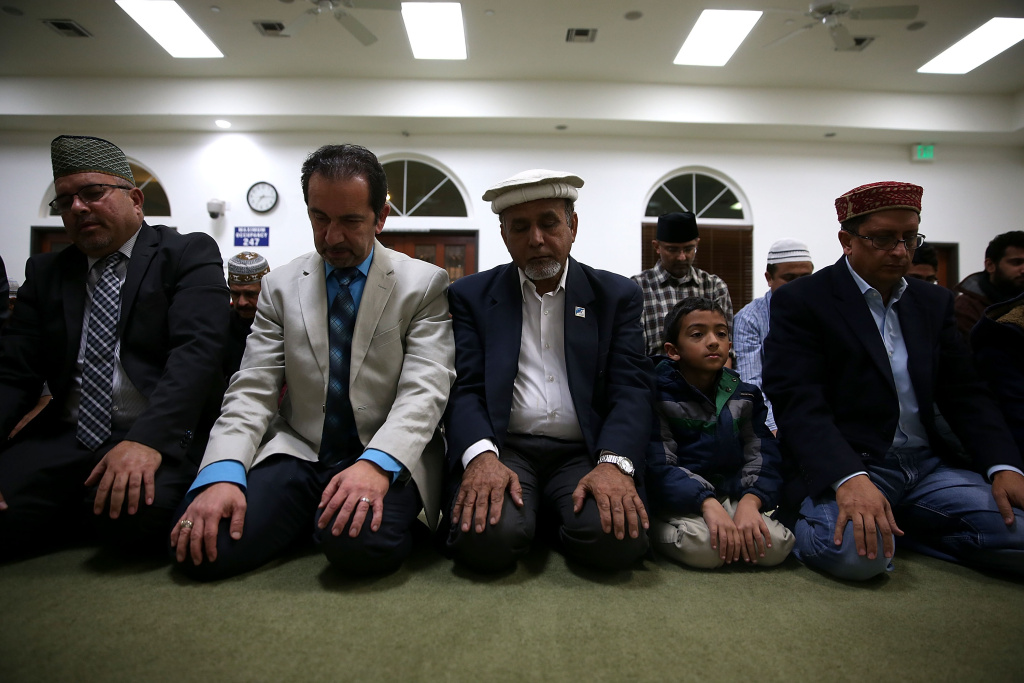 Muslim men pray in the mosque during a prayer vigil at Baitul Hameed Mosque on December 3, 2015 in Chino, California. The San Bernardino community is mourning as police continue to investigate a mass shooting at the Inland Regional Center in San Bernardino.