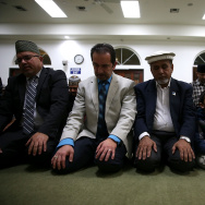 File: Muslim men pray in the mosque during a prayer vigil at Baitul Hameed Mosque on Dec. 3, 2015 in Chino.