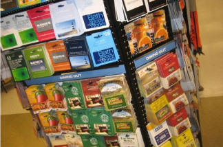 A rack at a store sells several store-branded gift cards.