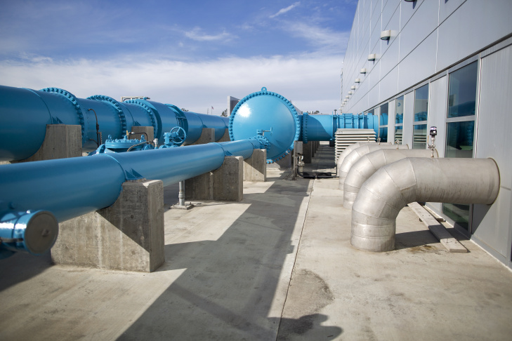 Water after each step of the three-part recycling process, from right to left. The left sink holds the final purified water that comes from Orange County's water recycling facility.