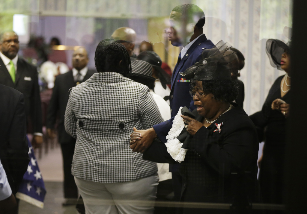 SUMMERVILLE, SC - APRIL 11:  Judy Scott weeps as she is escorted in for the funeral of her son, Walter Scott, at W.O.R.D. Ministries Christian Center, April 11, 2015 in Summerville, South Carolina. Scott was killed by a North Charleston police officer after a traffic Saturday, April 4, 2015. The officer, Michael Thomas Slager, has been charged with murder.