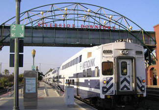A Metrolink passenger train car arrives at the downtown Riverside station.