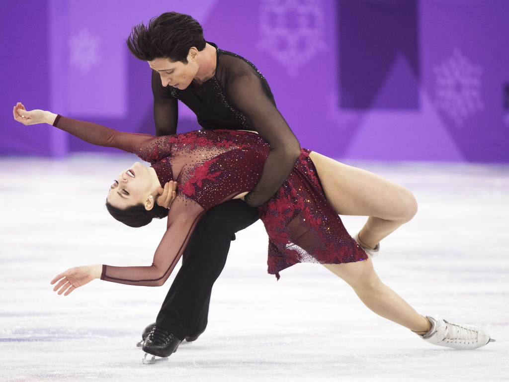 Tessa Virtue and Scott Moir of Canada perform during the ice dance free program.