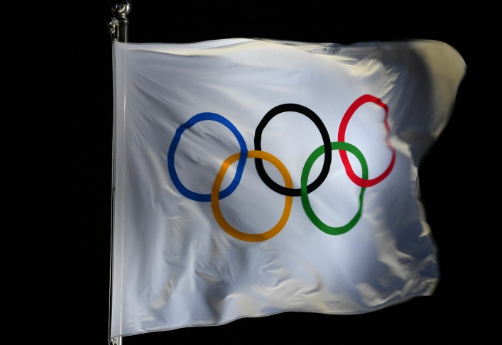 The Olympic flag bearing the Olympic rings flutters at the Pyeongchang Medals Plaza during the Pyeongchang 2018 Winter Olympic Games in Pyeongchang on February 12, 2018.