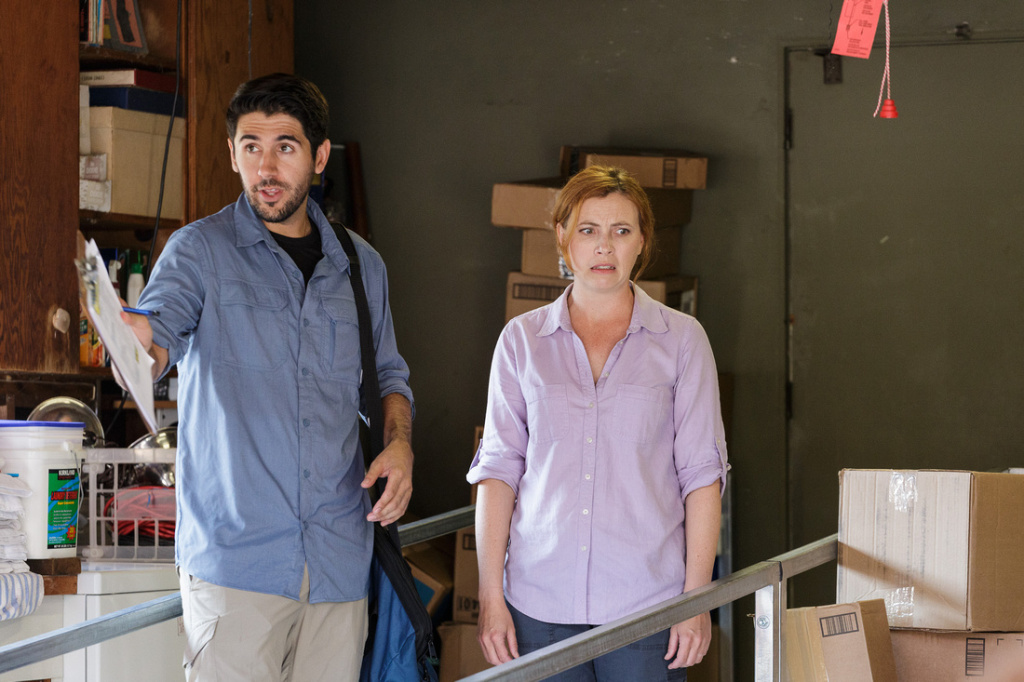 Actors Daniel Rubiano and Amy Ellenberger prepare for a disaster in a scene from Chalk Repertory Theatre's site-specific play,
