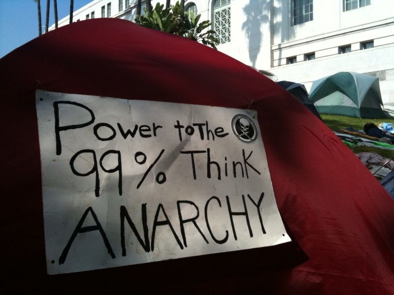 A sign on one of the tents set up outside Los Angeles City Hall as part of Occupy LA