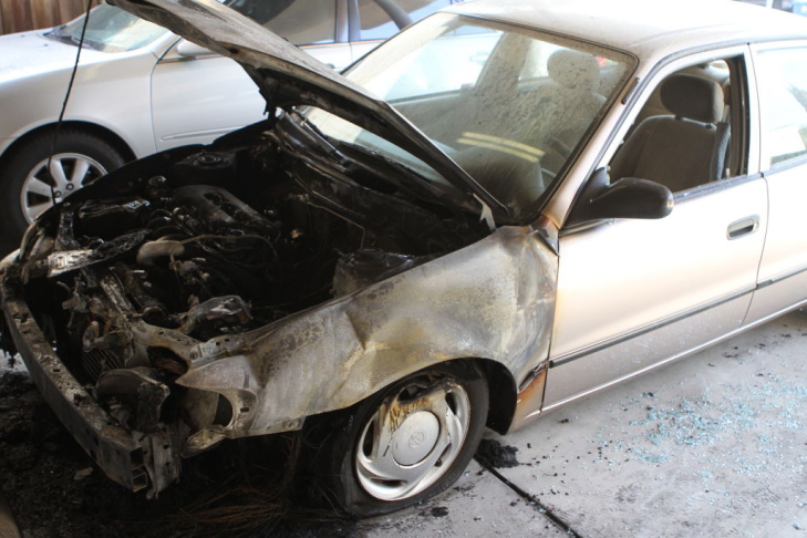One of the burned cars outside Jim Morrison's former residence on the 8000 block of Rothdell Trail.