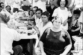 A typical Sunday family dinner in the Girod household. That's Jeff in suspenders, on the right. Actually, it's a photo from a big Italian family dinner in Boyle Heights, c. 1930. It's Mary, Josie, Frank Sr., and Frank Alfieri Jr.; Frank and Angie Charolla; Pete and Mary Principe; and Rosalie Stagno.