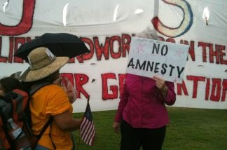 File photo: A supporter of SB 1070 engages in a conversation with Gloria Godoy, a Guatemalan American who came from Los Angeles to protest against Arizona's new immigration law.