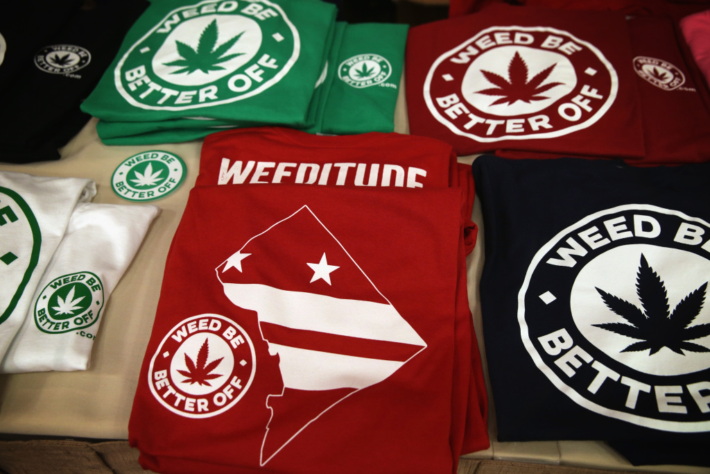 T-shirts with marijuana slogans are displayed during a ComfyTree Cannabis Academy conference February 28, 2015 in Washington, DC.
