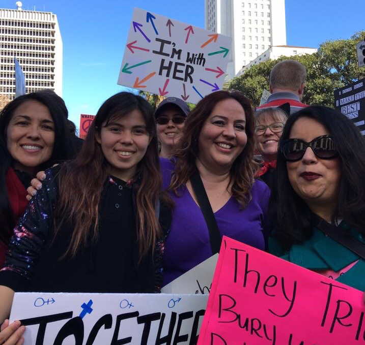 Nubia Cedeño, a resident of Long Beach, at left, along with other parents, educators from her community at the Women's March LA last Saturday.