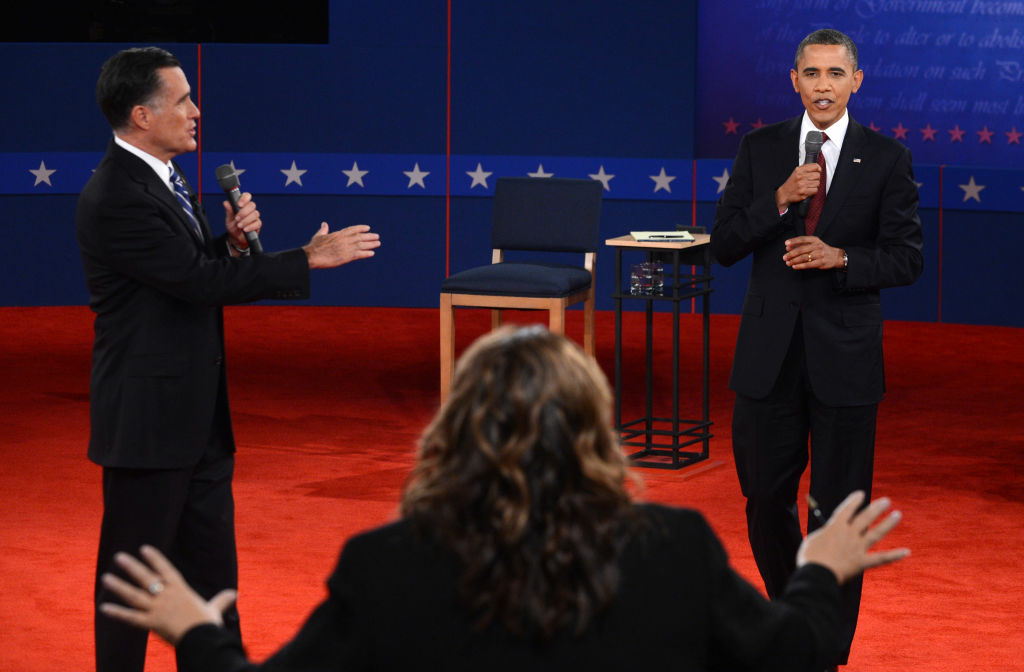 CNN's Candy Crowley (C) conducts the second presidential debate with US President Barack Obama (R) and Republican presidential candidate Mitt Romney (L) at the David Mack Center at Hofstra University in Hempstead, New York, Oct. 16, 2012.
