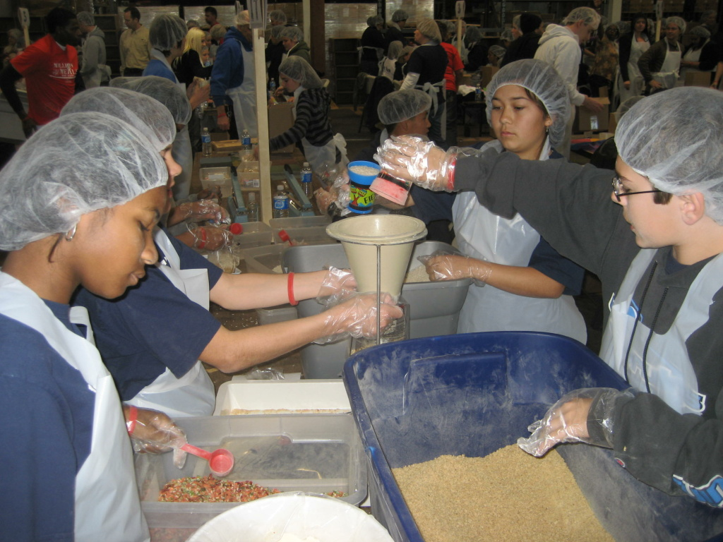 Students from the Westerly School of Long Beach volunteer on an assembly line at the Salvation Army warehouse in Bell.