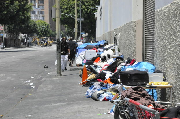 Two parks in the Skid Row area will remain open for another six months as the Los Angeles City Council moves around money to make up for the loss of redevelopment funds.
