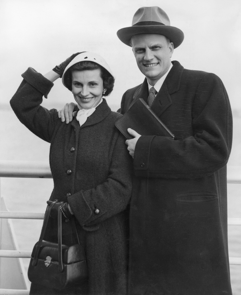 Billy Graham, the American evangelist, and his wife Ruth, pose aboard the liner