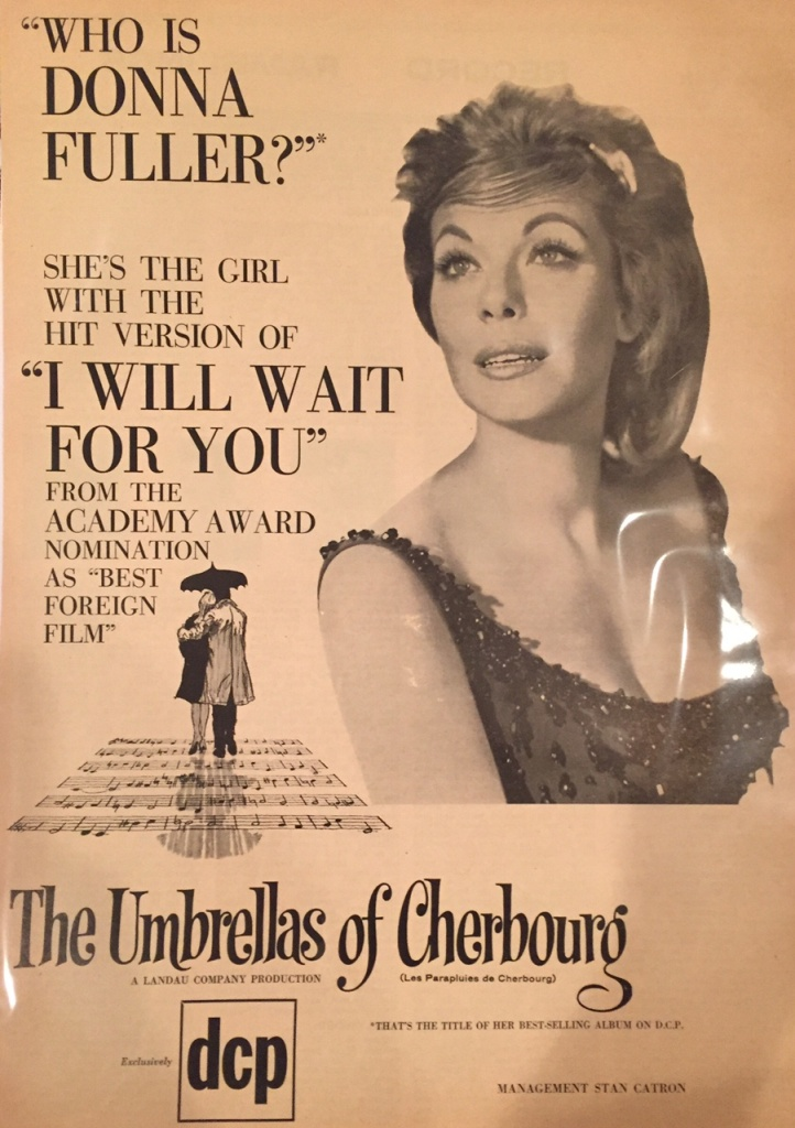 "An ad featuring Donna's version of hit song ""I Will Wait for You"" from the movie, ""The Umbrellas of Cherboug"""