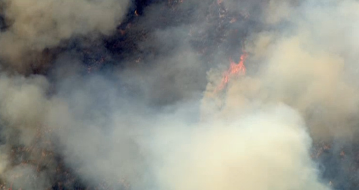 A wildfire reported shortly before 1 p.m. Thursday northeast of Los Angeles has so far burned 60 acres, authorities said.