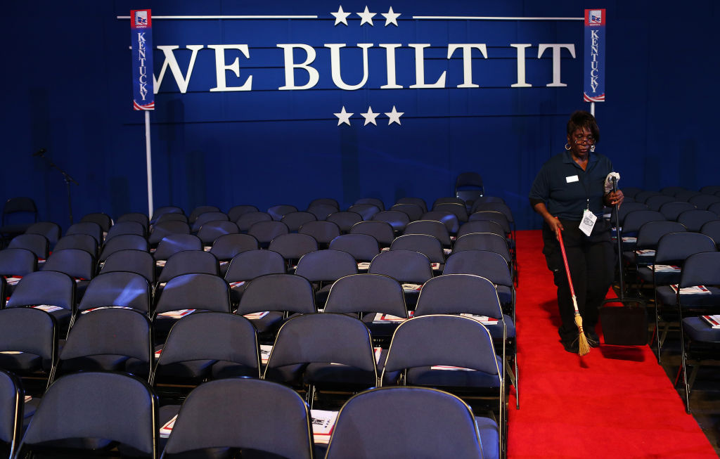 A woman sweeps the floor before the start of the second day of the Republican National Convention at the Tampa Bay Times Forum on August 28, 2012 in Tampa, Florida. Today is the first full session of the RNC after the start was delayed due to Tropical Storm Isaac.