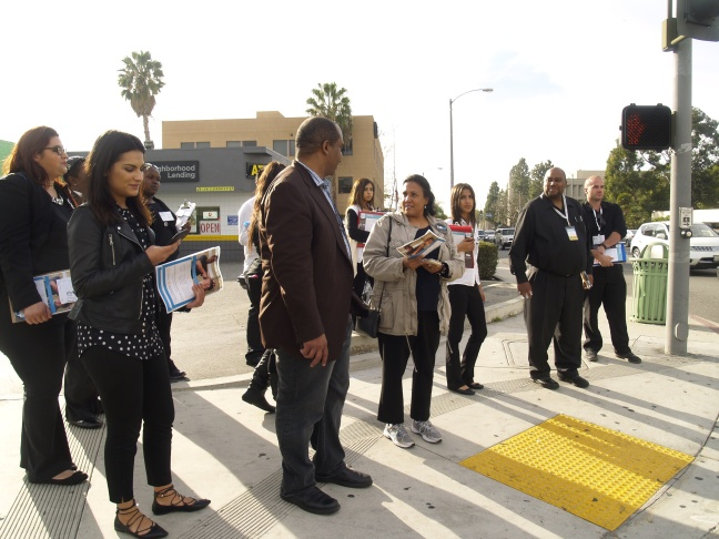 Covered California teams, armed with flyers, hit the streets in Inglewood to encourage people to sign up for health insurance before the January 31 deadline.