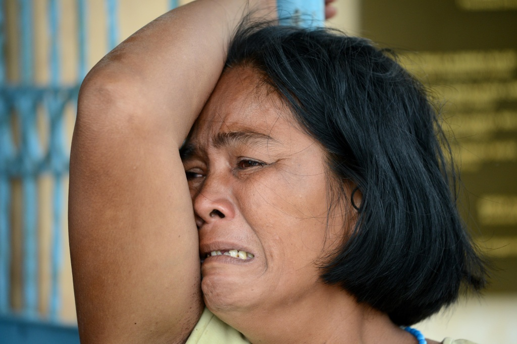 A woman mourns her dead son at a chapel in the aftermath of Super Typhoon Haiyan in Tacloban, on Saturday.