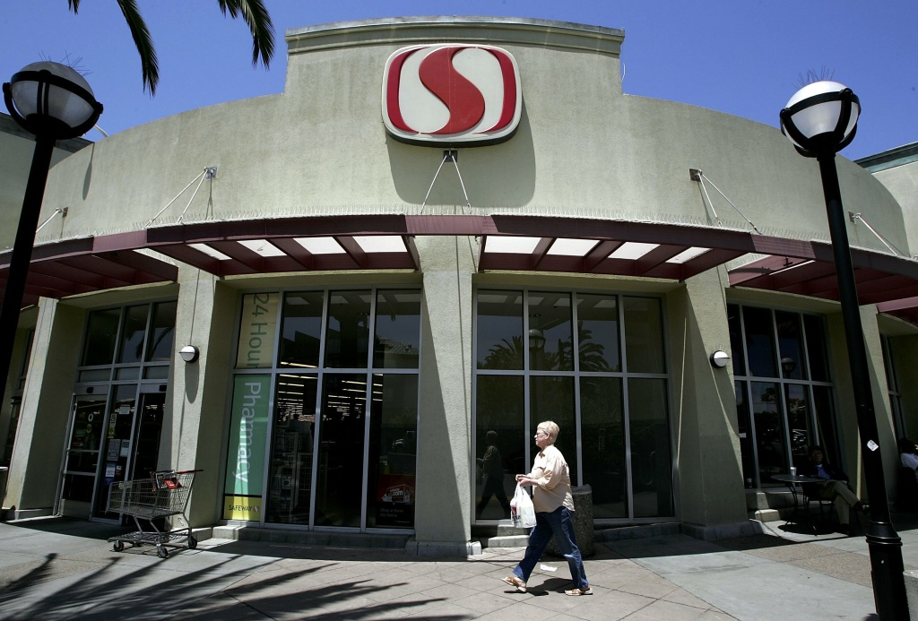 A Safeway customer walks in front of a Safeway grocery store July 20, 2006 in San Francisco, California.