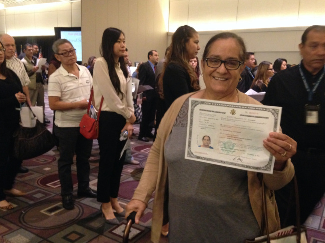 Manuela Resendez of Norwalk holds her U.S. citizenship certificate. Resendez became naturalized on Nov. 15, 2016 at the Pasadena Convention Center. She has lived in the U.S. since 1983, but applied for citizenship this summer because she wanted to vote and worried about her status.