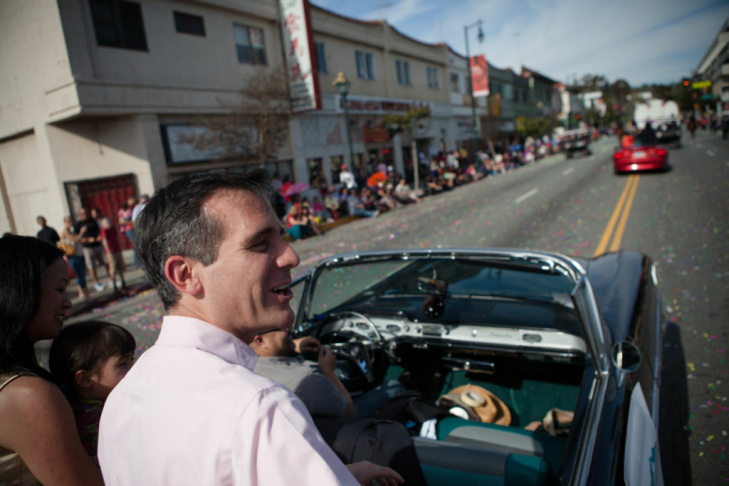 Eric Garcetti laughs with Gabriel Porras, left, and Marcel Porras, who works with Garcetti at City Hall.