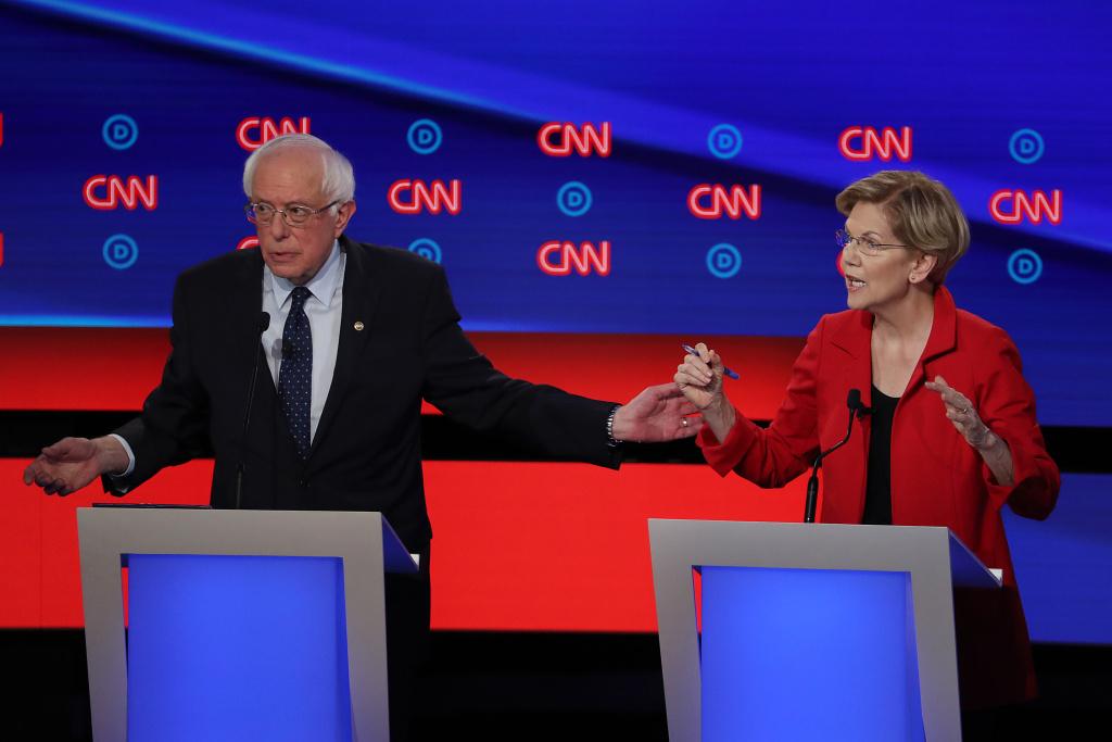 Democratic presidential candidate Sen. Bernie Sanders (I-VT) (L) and Sen. Elizabeth Warren (D-MA) speak during the Democratic Presidential Debate at the Fox Theatre July 30, 2019 in Detroit, Michigan.