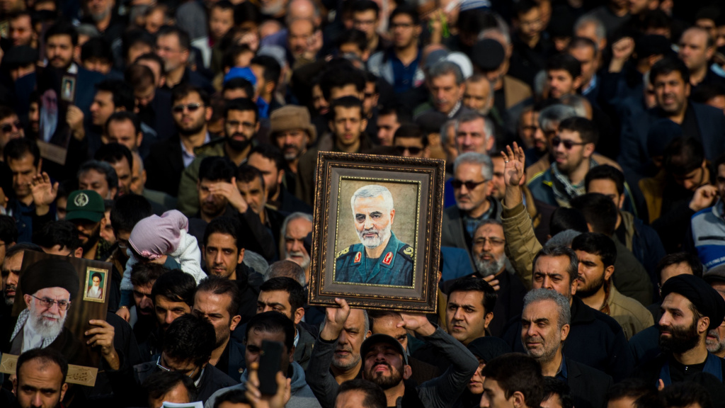 The U.S. killed Iranian Maj. Gen. Qassem Soleimani in a targeted drone strike in Baghdad. A U.N. investigator says the action violated Iraq's sovereignty. Here, protesters in Tehran, Iran, hold up an image of Soleimani during a demonstration on Jan. 3.
