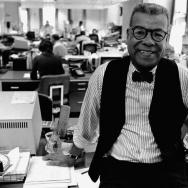 Chuck Stone poses in the newsroom of the Philadelphia Daily News on Feb. 15, 1984.