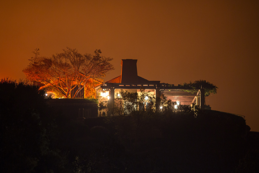The Thomas Fire approaches a home on December 12, 2017 in Montecito, California.
