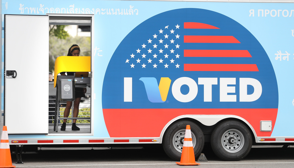 A voter prepares her ballot during early voting for the California presidential primary election at a new L.A. County 'Mobile Vote Center' in Universal City, California.
