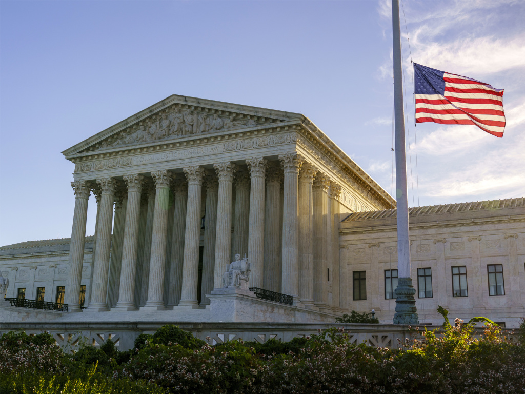 The flag flies at half-staff Saturday at the Supreme Court on the morning after the death of Justice Ruth Bader Ginsburg.