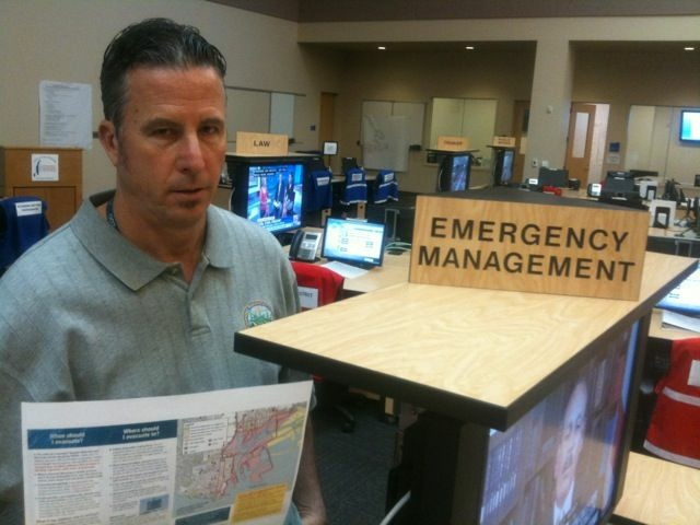 Chris Ipsen with a tsunami preparedness brochure at Los Angeles' Emergency Operations Center